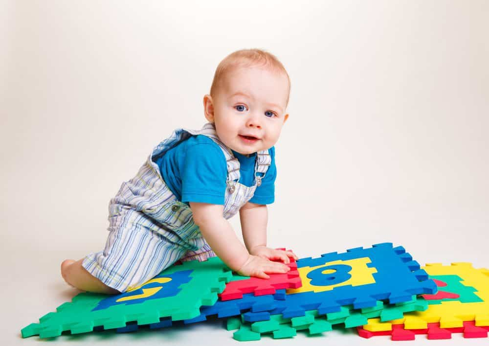 Jump and Play baby playing with numbers Contact us