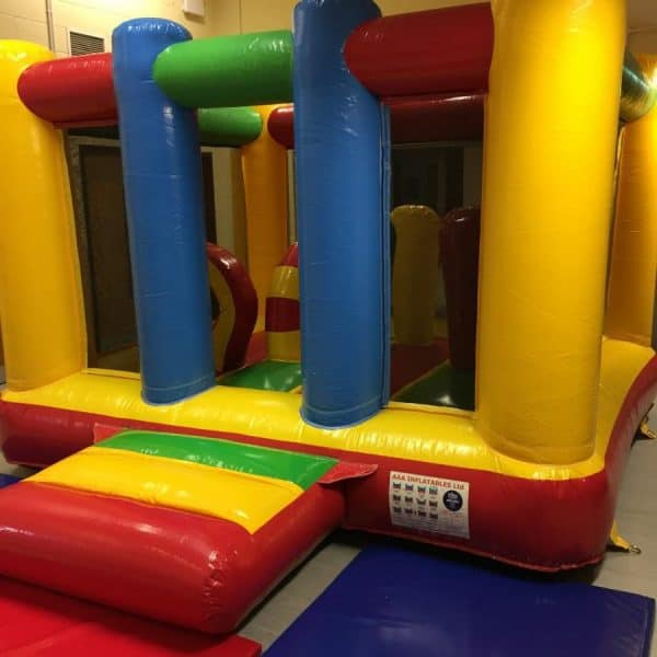 Jump and Play Low Height Bouncy Castle e1511260505902 600x600 Rainbow Bouncy Castle