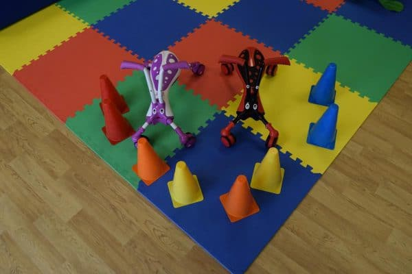 Jump and Play Scramble bugs with cones 3 Enormous Soft Play Party & Dinosaur Bouncy Castle