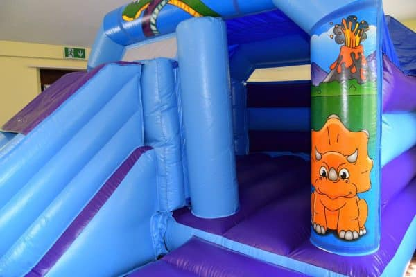 Jump and Play Cute dinosaur Bouncy castle Dinosaur Bouncy Castle with Front Slide