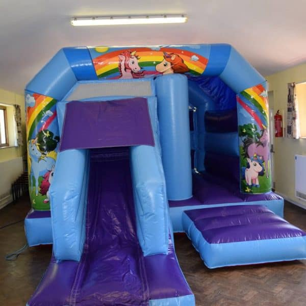 Jump and Play Low height unicorn bouncy castle with slide 600x600 Soft Play Hire in Steyning Play Equipment Hire