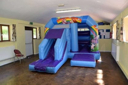 unicorn bouncy castle with front slide