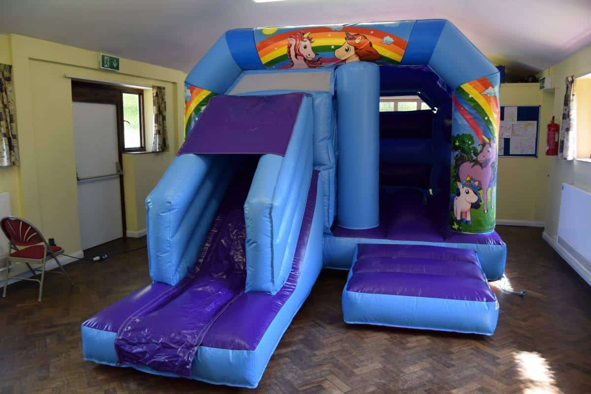 Jump and Play indoor unicorn bouncy castle with slide Soft Play Hire in Steyning Play Equipment Hire