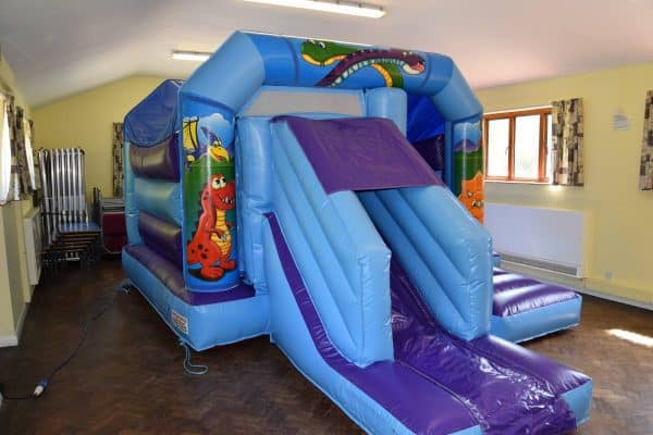 Jump and Play low height dinosaur bouncy castle with slide Dinosaur Bouncy Castle with Front Slide